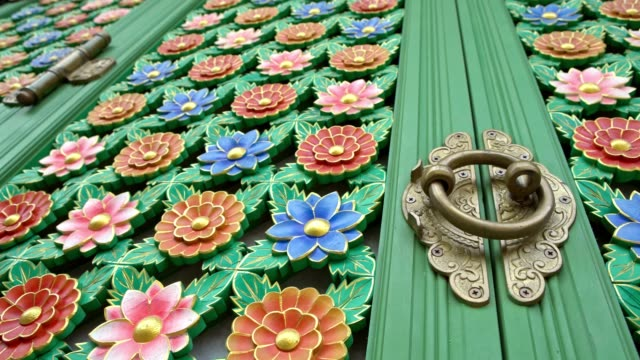 4K Beautiful green floral latticework that adorn the doors of temple Busan