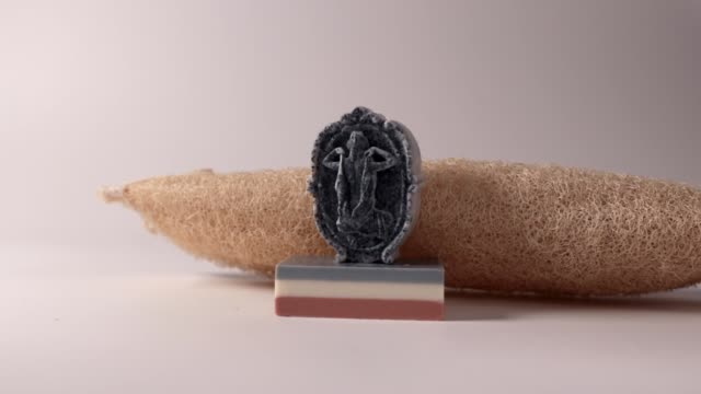 Beautiful handmade soap bar on white background .Charcoal skin care soap