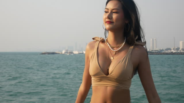Beautiful happiness young Asia woman traveling beach on boat in summer weekend.