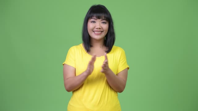 beautiful happy asian woman clapping hands - юго восток стоковые видео и кадры b-roll
