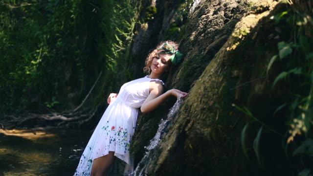 Beautiful hippie girl posing in nature video