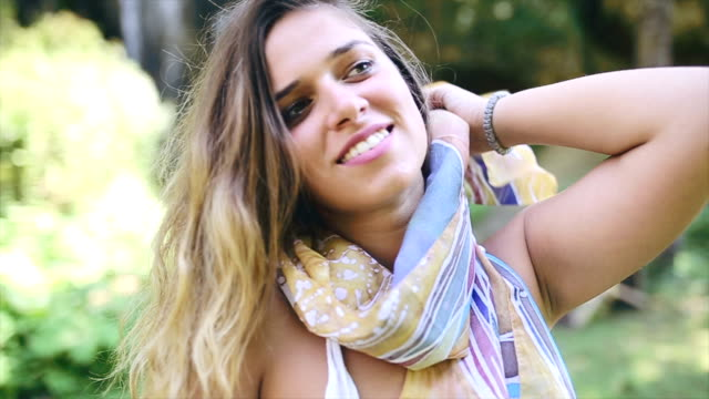 Beautiful hippie girl posing in nature video