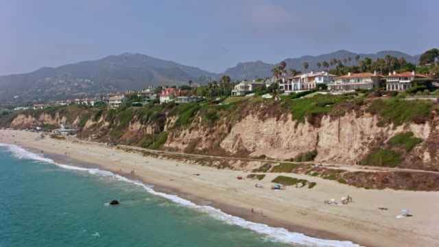 AERIAL Beautiful homes on a cliff in Malibu