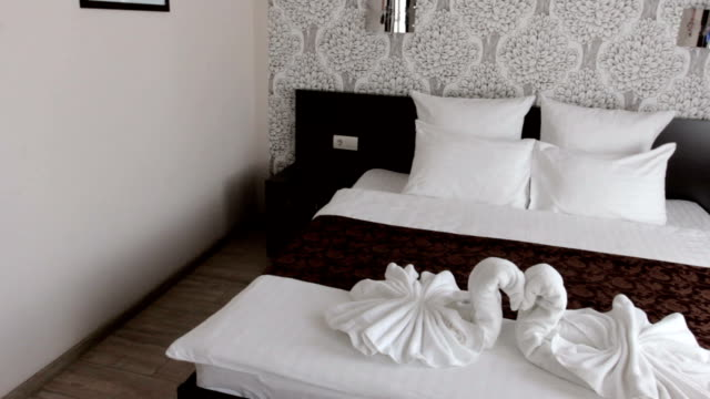 beautiful hotel room with a double bed beautiful hotel room with a double bed. double bed stock videos & royalty-free footage