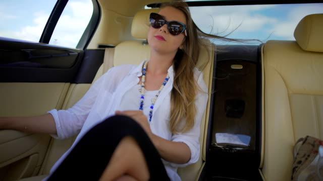 Beautiful independent woman enjoying car trip on vacation, business traveler video
