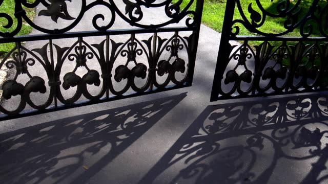 vídeos de stock e filmes b-roll de beautiful iron gate beautiful iron gates - cercado