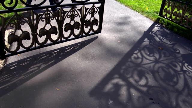 Красивые железные ворота  Beautiful iron gates Beautiful iron gates wrought iron stock videos & royalty-free footage