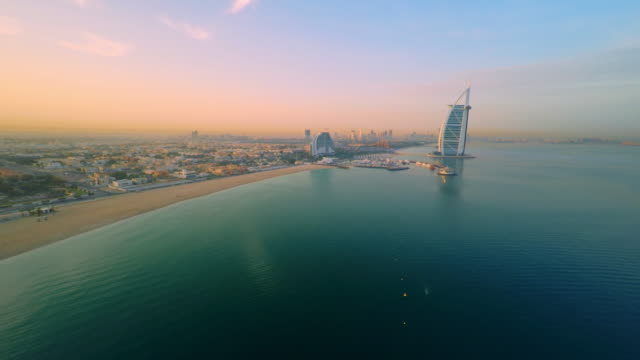 aerial beautiful jumeirah beach with burj al arab hotel - dubai architecture stock videos & royalty-free footage
