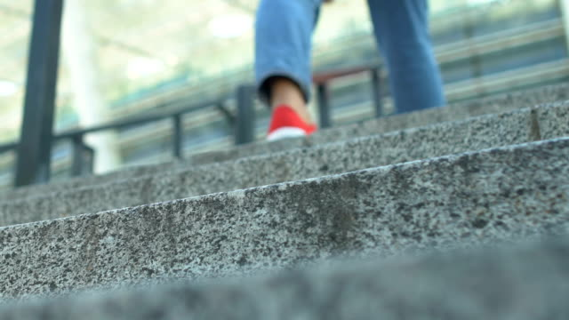 Beautiful lady dressed in casual clothes going up stairs in city, students life Beautiful lady dressed in casual clothes going up stairs in city, students life stepping stock videos & royalty-free footage