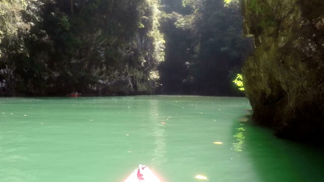 Beautiful Lagoon View From Kayak Moving Between Mountains Action Camera Point Of View Boat Nose Kayaking In Sea video