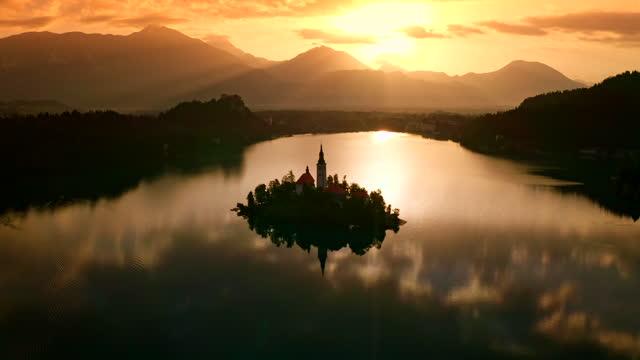 AERIAL Beautiful Lake Island at sunset