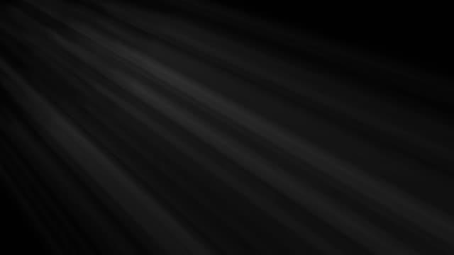 아름다운 렌즈는 검은 배경에 원활한 루프를 플레어. 자신의 푸티지에 오버레이로 같은 건달 효과 - 태양광선 스톡 비디오 및 b-롤 화면