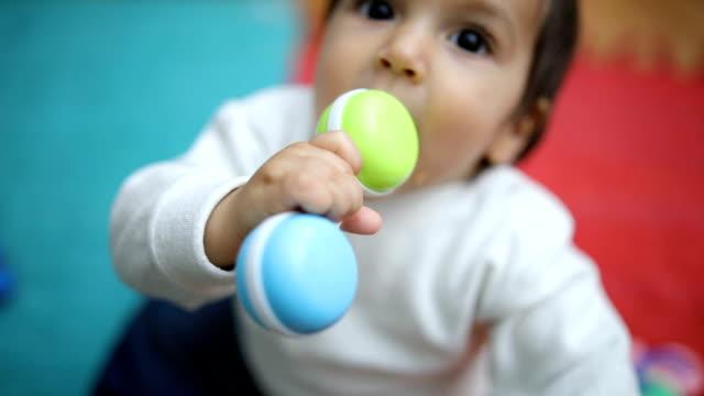 stockvideo's en b-roll-footage met prachtige kleine jongen - baby toy