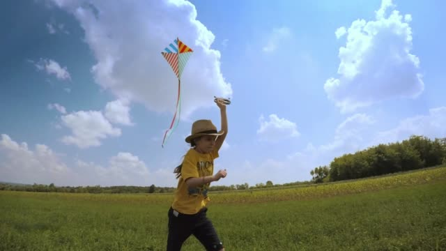 Beautiful Little Girl Flying A Kite. Happy Memories Of Her Young Days