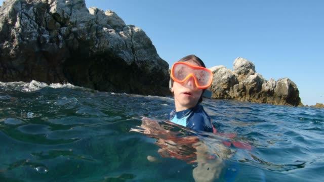 Beautiful Little Girl Having Fun in a Sea. video