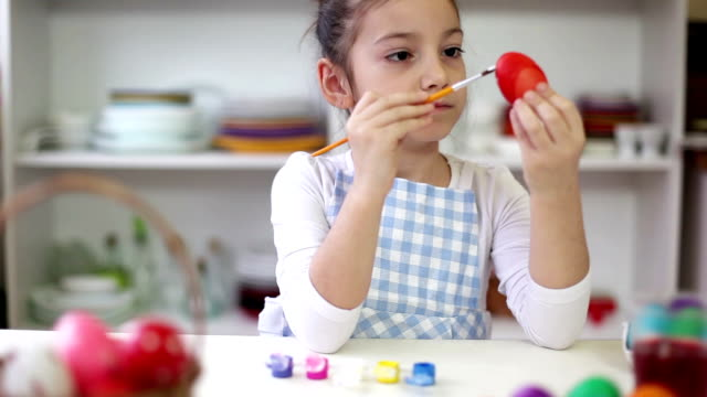 Beautiful Little girl painting Easter eggs video