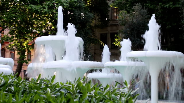 Beautiful live fountains of bubbling water in the park in Baku, Azerbaijan.Shinning splash of water video