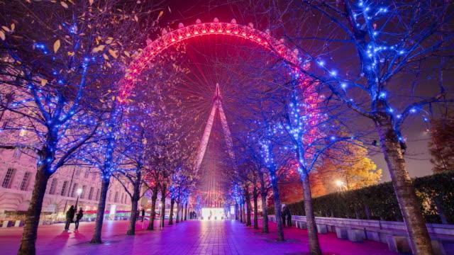 t/l beautiful london eye at night - data scritta video stock e b–roll
