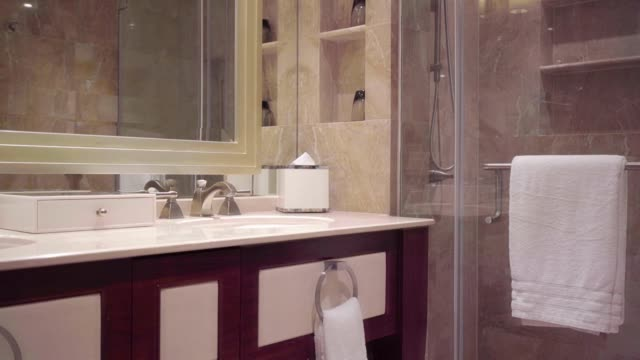 Beautiful luxury bathroom interior with sink faucet and bathtub