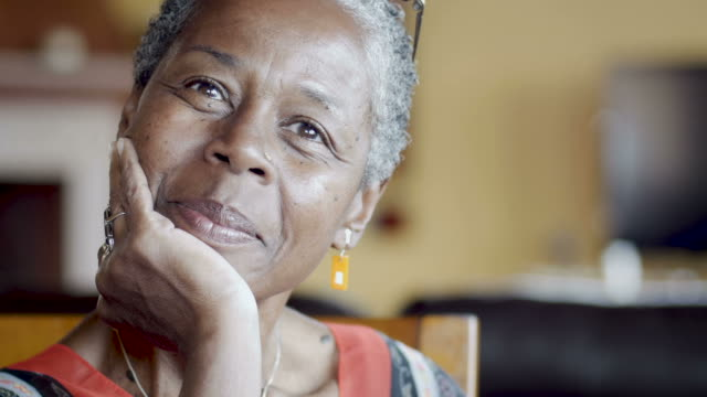 Beautiful mature senior African American woman nodding and listening video