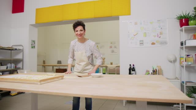 Beautiful mature woman at culinary workshop