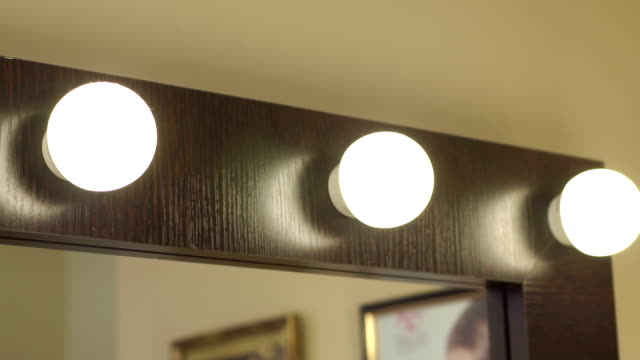 Beautiful mirror with lamps in the beauty salon. video