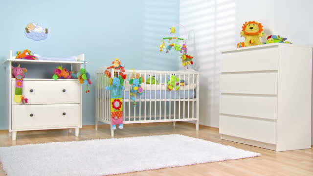 HD DOLLY: Beautiful Modern Nursery HD1080p: DOLLY shot of a beautiful bright nursery decorated with soft toys in vibrant colors. All visible toys are official property released. playroom stock videos & royalty-free footage