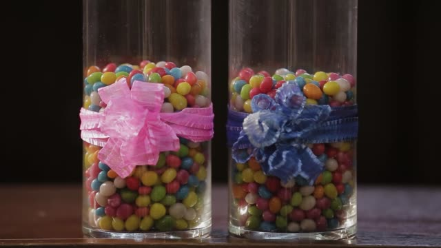 Beautiful multi-colored candies in glass containers