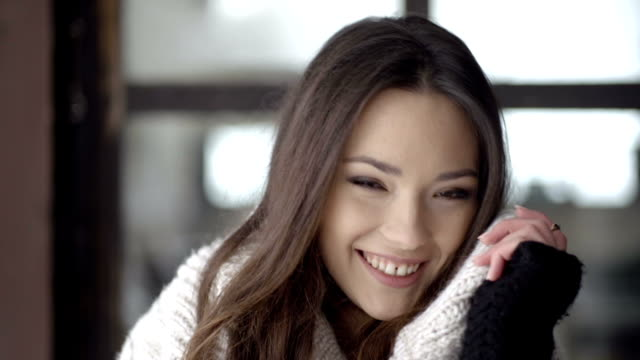 Beautiful natural face of young brunette woman smiling to a camera. video