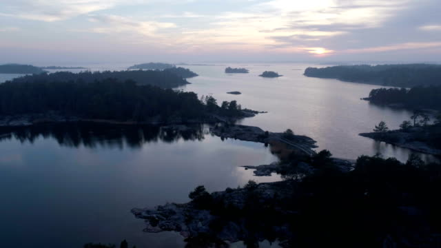 Beautiful nature and landscape video of sunset at Stendorren in Nykoping, Sweden Beautiful nature and landscape video of sunset at Stendorren in Nykoping, Sweden. Nice autumn evening at the sea, Filmed with drone from sky, nyköping stock videos & royalty-free footage