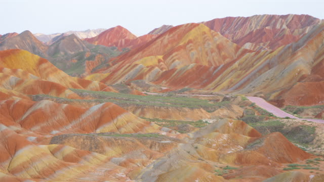 Beautiful nature landscape view of Zhangyei Danxia Landform in Gansu China. Beautiful nature landscape view of Zhangyei Danxia Landform in Gansu China. sandstone stock videos & royalty-free footage