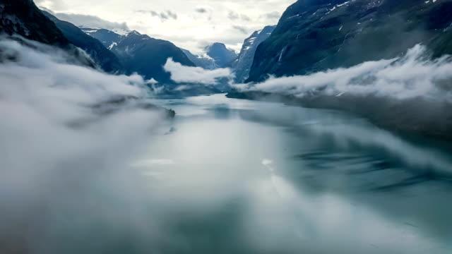 vídeos de stock e filmes b-roll de beautiful nature norway natural landscape lovatnet lake flying over the clouds. - noruega