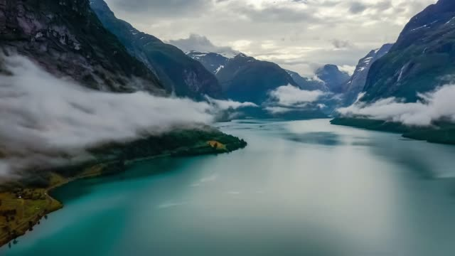vídeos de stock e filmes b-roll de beautiful nature norway natural landscape lovatnet lake flying over the clouds. - fiorde