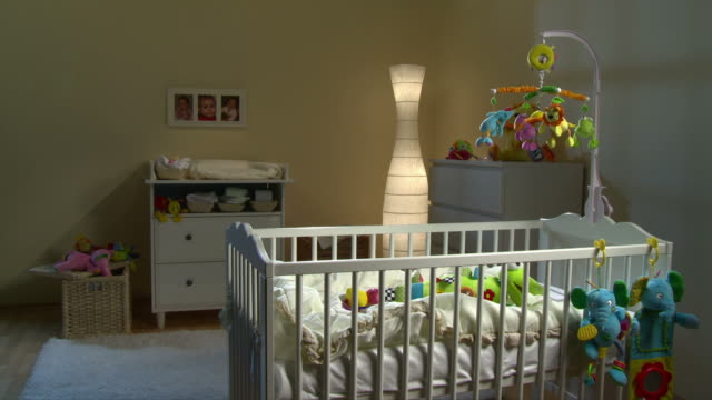 HD: Beautiful Nursery Room At Night HD1080p: Night shot of a beautiful warm nursery room decorated with soft toys and rotating crib mobile toy. All visible toys are official property released. low lighting stock videos & royalty-free footage