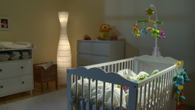stockvideo's en b-roll-footage met hd dolly: beautiful nursery room at night - baby toy