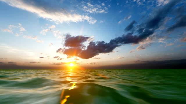 beautiful ocean sunrises and sunsets - спокойная вода стоковые видео и кадры b-roll