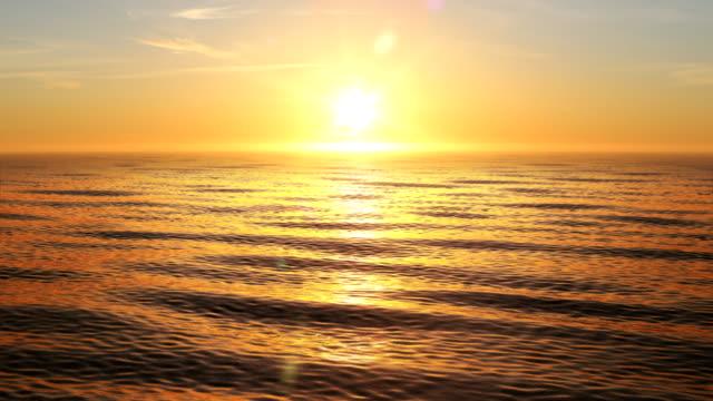 piękny pomarańczowy zachód słońca w ocean looped 3d animacja. słońce świeci jasne z flarami. - horyzont wodny filmów i materiałów b-roll