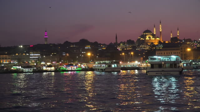 Beautiful panning View touristic landmarks at Eminönü (Turyol)  harbour at twilight