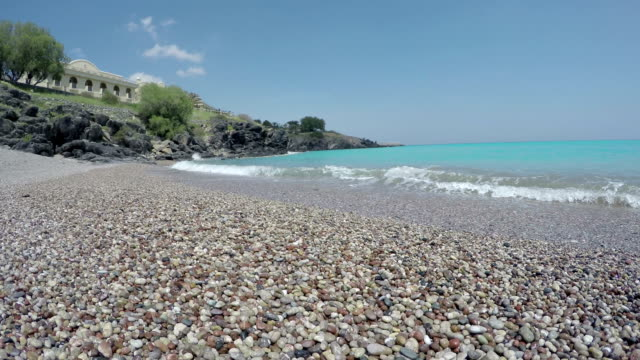 beautiful pebbles stone beach in Lindos resort, Rhodes island, Greece. Time-lapse video