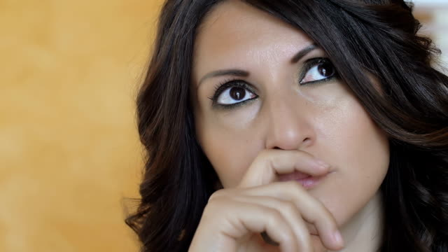 beautiful pensive woman in the office: worker, thinking, thoughts video
