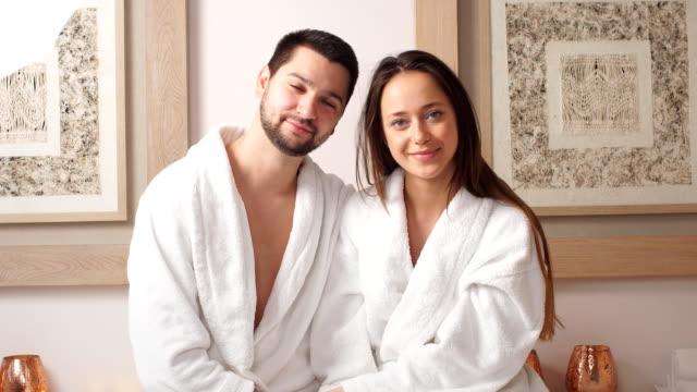 beautiful pleasant couple having good time in modern wellness salon - viziarsi video stock e b–roll