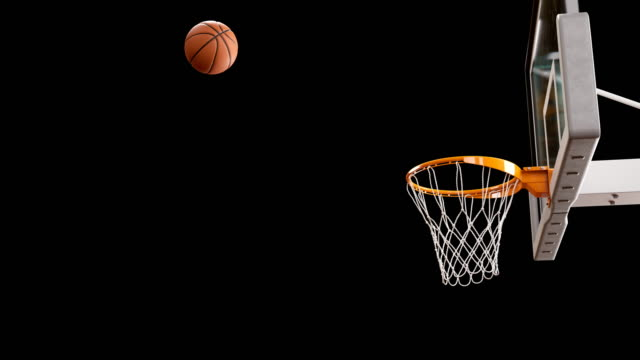 Beautiful Professional Throw in a Basketball Hoop Slow Motion. Ball Flying Spinning into Basket Net on Black Background. Sport Concept. 3d Animation 4k Ultra HD 3840x2160. video