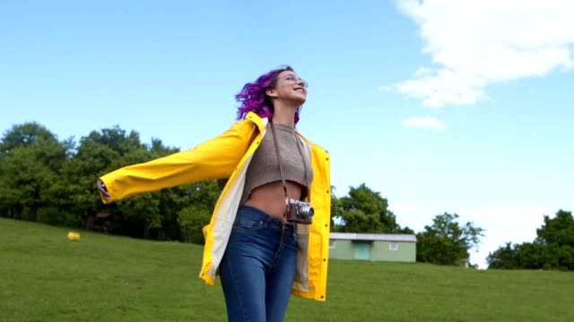 Beautiful purple haired girl enjoying the day outdoors