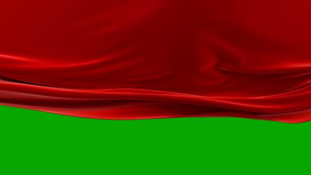 vacker röd viftande trasa flytta upp öppna bakgrunden. abstrakt 3d-animering med alpha matte. vågig siden tyg yta rörelse avslöjande screen. - red silk bildbanksvideor och videomaterial från bakom kulisserna