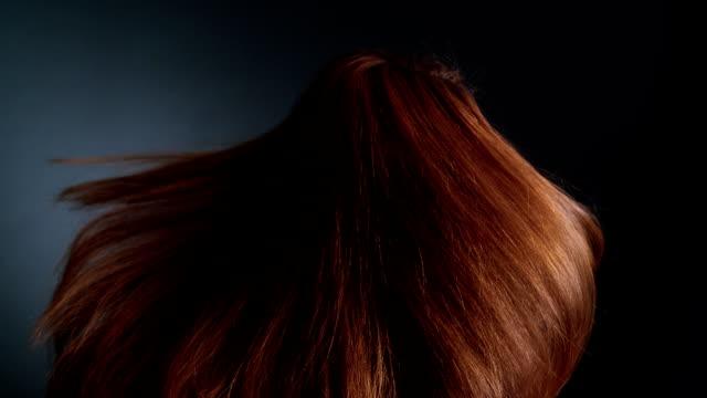 Beautiful redhead girl rotating. Her long hair waves