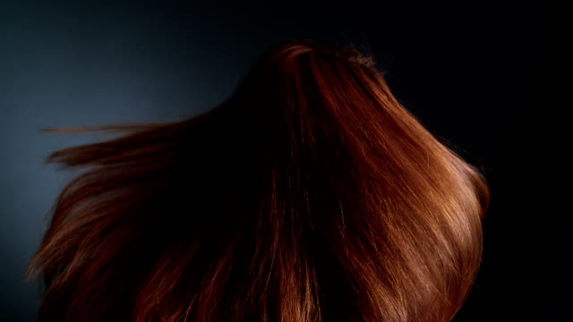 Beautiful redhead girl rotating. Her long hair waves Studio shot of attractive redhead woman tossing her healthy, long hair. Super slow motion. Shot with Phantom 2K long hair stock videos & royalty-free footage