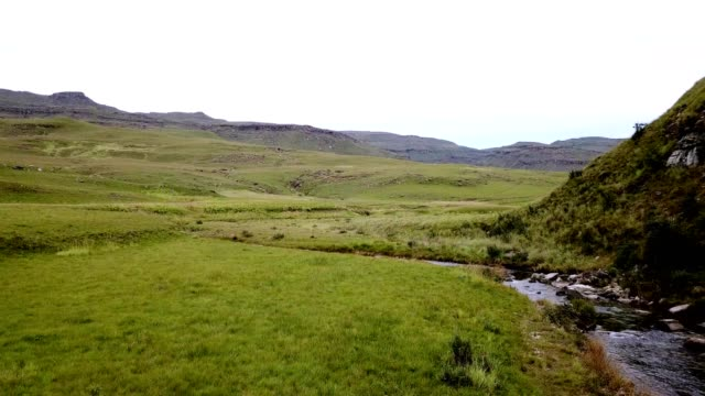 Beautiful river flowing through the valley A beautiful river flows through the foothills of the mountains close to the Drakensberg, South Africa natal stock videos & royalty-free footage