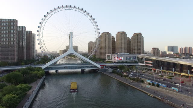 beautiful river through modern buildings and ferris wheel video