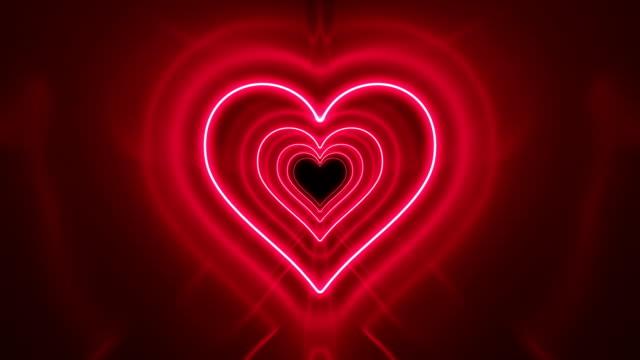 Schöne romantische abstrakte Tunnel Herzform mit Neon Lichter bewegen nahtlos. Rote helle Farben futuristischen Hintergrund leuchtende Lichter. Looped 3d Animation Art Konzept. – Video