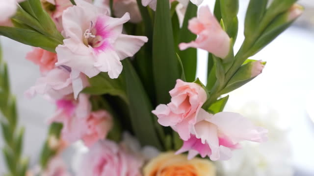 Beautiful roses and gladiolus in a bouquet video